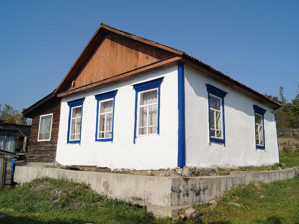 Фото: Отдельно стоящий дом с видом на озеро и город